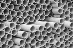 Asbestos pipes for drain in construction site. Texture for background. Asbestos pipes for drain in construction site Stock Photo