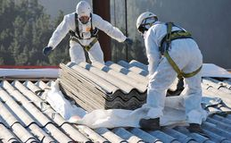 Asbestos-103. Professional worker removing asbestos roof Royalty Free Stock Photography