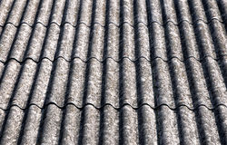 Asbestos roof. Close up on corrugated asbestos roof on byre building in Poland Stock Photos