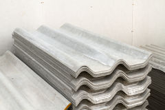 Asbestos roof. Stack of asbestos roof in warehouse Stock Photos