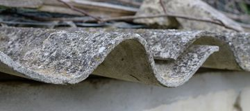 Free Asbestos Roof. Dangerous Asbestos Dust In The Environment. Health Problems Stock Images - 160185614