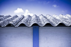 Asbestos roof. Medical studies have shown that the asbestos particles can cause cancer Stock Photography