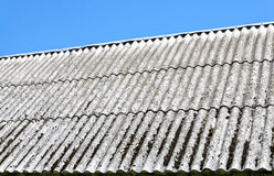 Asbestos roof. Outdoor panel, blue sky Stock Images