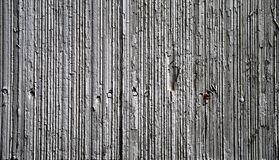 Asbestos shingle. Grey asbestos shingle with a row of nails (one rusted royalty free stock images