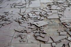 Asbestos tiles. Old and broken asbestos floor tiles Stock Image