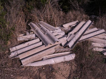Asbestos tiles. Abandon the construction waste in the country that does not respect human vice nature Stock Image
