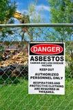 Asbestos Warning. Warning sign of asbestos exposure on fence Stock Image