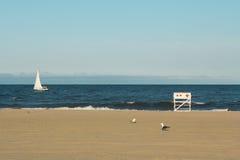 Asbury在日落期间的公园海滩 免版税库存照片