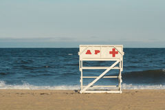 Asbury Park New Jersey Lifeguard Chair. An empty Asbury Park Beach Patrol lifeguard chair faces the Atlantic Ocean during the evening at sunset royalty free stock images