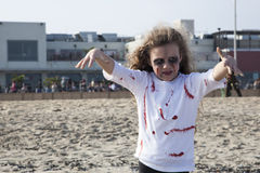Asbury Park Zombie Walk 2013 - Little Zombie Girl. Photos of Zombies walking on the boardwalk and through the streets of Asbury Park, New Jersey during the 2013 Stock Photo