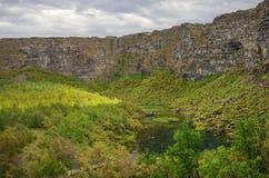 Asbyrgi canyon in Jokulsargljufur national park and green lake w. Ith refflection, Iceland Royalty Free Stock Photography