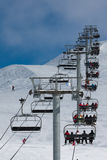 Ascend on chairlift. Long ascend on chairlift. Ski resort royalty free stock photos