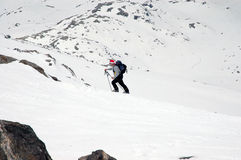 Ascending. Ski mountaineering or cross country skiing in Italian Alps Royalty Free Stock Photos