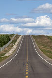 Ascending asphalt road stock image