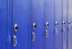 Ascending Blue Lockers. Ascending Blue High School Lockers with a spin dial for the combination code royalty free stock photos