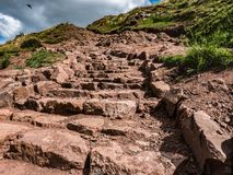 Ascending Climb to Arthur`s Seat, Edinburgh, Scotland. View see while climbing up the dirt footpath to the summit of Arthur`s Seat, a volcanic crag in Holyrood Royalty Free Stock Photos