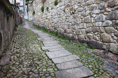 Ascending Cobbled Street in the Old Town Stock Images