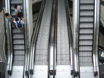 Ascending and descending escalators in Mega Mall in Bucharest, Romania on June 19, 2015 Stock Photo