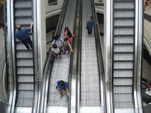 Ascending and descending escalators in Mega Mall in Bucharest, Romania on June 19, 2015 Royalty Free Stock Photos