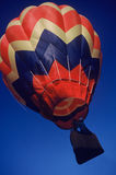 Ascending fast. Hot Air Balloon rising fast royalty free stock image