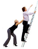 Ascending the ladder. Photo of businessman ascending the ladder with pretty woman helping him Stock Photo