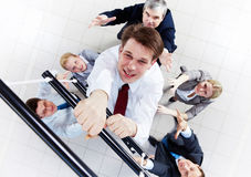 Ascending the ladder stock photos