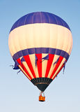 Ascending Red White and Blue Balloon Royalty Free Stock Image