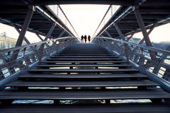 Ascending Stairs. A group of silhouettes is ascending a modern staircase in Paris stock photo