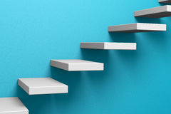 Ascending stairs on the blue wall Stock Photography