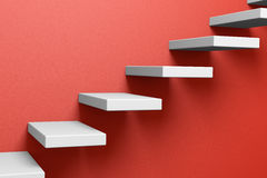 Ascending stairs on the red wall Stock Photography