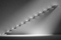 Ascending stairs of rising staircase in dark empty room with lig Stock Photo