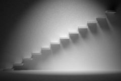 Ascending stairs of rising staircase in dark empty room with spo Royalty Free Stock Images