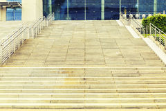 Stairs. Ascending stone stair (or stairs staircase stairway steps) in front of business commercial office building Stock Photo