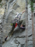 Ascending towards the goal. Lead climber powering upwards to meet the challenge Stock Photos