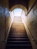 Dark stairs lit up light Royalty Free Stock Image