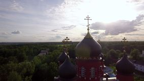 Ascension Cathedral and Holy Cross Monastery in green countryside, Russia. Flying over Ascension Cathedral and Holy Cross Monastery in Lukino Village with stock video footage
