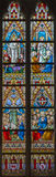 The Ascension of Jesus and Pentecost, and Resurrection scene on the windowpane in st. Jacobs church Stock Photos