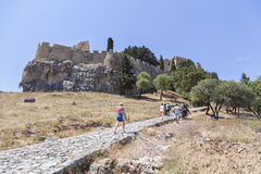 The ascent to the Acropolis on the backs of donkeys. Lindos stock photos