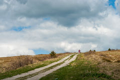 Ascent to the top of the mountain on a bicycle. Royalty Free Stock Photo