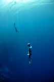 Ascenting from the depth by breaststroke Stock Photo