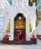Ascetic Buddhist monk meditating at Shwedagon Paya pagoda , Yang. YANGON, MYANMAR-MARCH 2, 2017: Ascetic Buddhist monk meditating at Shwedagon Paya pagoda on stock image