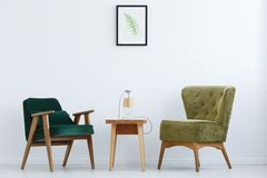 Ascetic interior with green chairs. Ascetic, white home interior with green chairs, table and lamp stock images