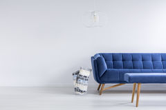 Ascetic living room with sofa. Ascetic living room in white with blue sofa and bench royalty free stock images