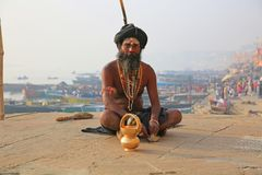 Colorful Ascetic On Platform Along Ganges River, Varanasi, India. Ascetic in lotus position on a ghat along the Ganges River in Varanasi, India royalty free stock photography