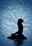 Ascetic meditating on a rock Royalty Free Stock Images