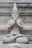 Ascetic statue in Thai style molding art, from sement. Cement ascetic statue in Thai style molding art Royalty Free Stock Images
