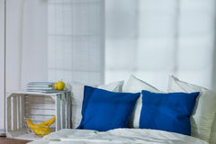 Ascetic but stylish bedroom Stock Images