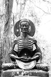 Asceticism Buddha Statue. In black and white stock photo
