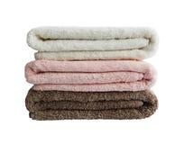 Asciugamani di bagno in pila isolata Immagini Stock