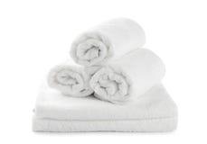 Asciugamano di spiaggia bianco acciambellato Fotografie Stock